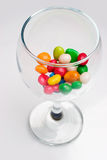 Glass filled with candies Royalty Free Stock Image