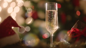 Glass filled with champagne on New Years night stock footage