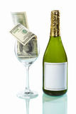 Glass filled of dollar bills and wine bottle Stock Photography