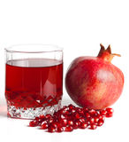 Glass filled by juice of a pomegranate Royalty Free Stock Photo