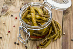 Glass filled with pickled Chilis Royalty Free Stock Photo