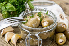Glass filled with pickled Olives Royalty Free Stock Photography