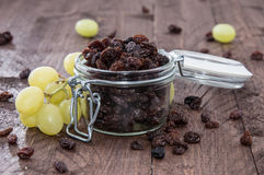 Glass filled with Raisins (and Grapes) Stock Photo