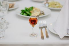 Glass filled by red wine stock photography