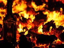 Glass fire flame heat hot bright. Burning inside what`s outside the glass in the furnace all the heat of the flared up the coals drinks hangover small hot pepper Stock Image