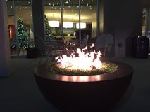 Glass fire pit at Christmas at night Royalty Free Stock Photo