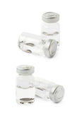 Glass flask with an eye lenses isolated. Glass flask with a scary Halloween eye lenses isolated over the white background, set of two different foreshortenings royalty free stock photo