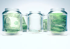 Glass flasks with money and glass flask with three banknotes. With coins - wealth and poverty concept Stock Photos