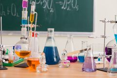 Glass flasks with multi-colored liquids at  chemistry lesson Stock Images