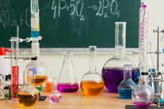 Glass flasks with multi-colored liquids at chemistry lesson. Glass flasks with multi-colored liquids at the chemistry lesson Stock Image