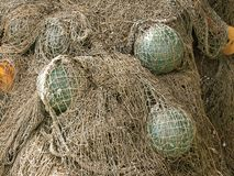 Glass float, old fishing nets. Catch closeup Royalty Free Stock Image