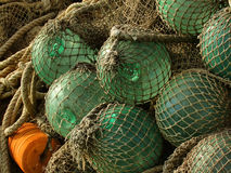 Glass float, old fishing nets Royalty Free Stock Photos