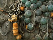 Glass float, old fishing nets Stock Photos