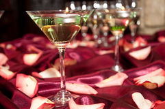 Glass with floating candles. Floating Candles with pink Rose petals on a Wedding reception table Royalty Free Stock Photo