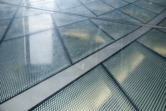 Glass floor in the office of New Babylon. Royalty Free Stock Photo