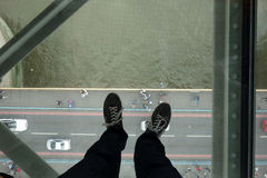 Glass floor in the Tower Bridge. The Tower Bridge is one of Great Britain`s most famous landmarks Royalty Free Stock Photo