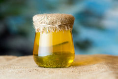 Glass flower honey jar Royalty Free Stock Photo