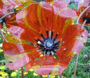 Glass flower sculpture. A mix of yellow, orange, stripes, and gold, daisies Stock Photo