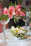 Glass and flowers. Plates and glasses decorated with flowers Stock Photos