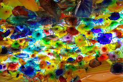 Glass flowers on the ceiling in Bellagio Hotel in Las Vegas. LAS VEGAS, NEVADA, USA - OCTOBER 21, 2013 : Glass flowers on the ceiling in Bellagio Hotel in Las royalty free stock image