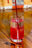 Glass in flowing strawberry juice Stock Photos