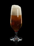 Glass with foamy beer Royalty Free Stock Photo