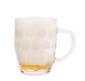 Glass of foamy beer on white background. 90%. Royalty Free Stock Image