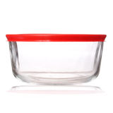 Glass food container with red plastic lid  on white. Background Royalty Free Stock Photo