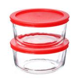 Glass food containers with red plastic lids isolated on white Royalty Free Stock Photo