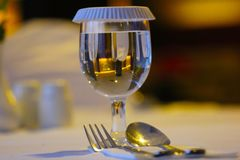 Glass, fork and spoon Royalty Free Stock Photography