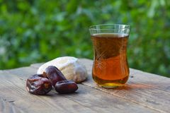 Glass of fragrant tea with dates and gingerbread Stock Photo