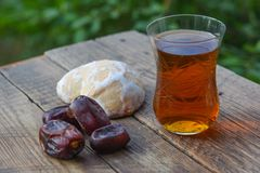 Glass of fragrant tea with gingerbread Stock Image