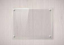 Glass frame on a wooden surface Royalty Free Stock Photos