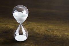 Glass framlägga tidbegrepp för timme Arkivfoto