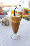 Glass of frappe. Greek cold iced coffee on table stock photos