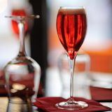 Glass with French alcohol drink Kir Royal Royalty Free Stock Photos