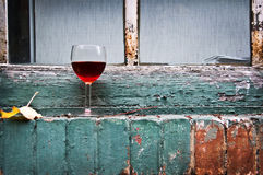 Glass of French red wine near a window Stock Photo