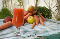 A glass of fresh apple carrot juice Royalty Free Stock Images