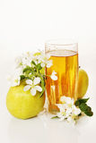 Glass of fresh apple juice and ripe green apples Stock Images