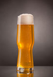 Glass of fresh beer with cap of foam Royalty Free Stock Photos