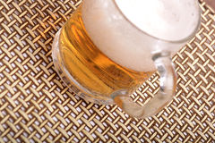 Glass of fresh beer with cap of foam Stock Photo