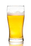Glass of fresh beer with drops on white background Stock Photo