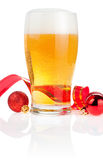 Glass fresh beer,  Red ribbon and Christmas Balls Royalty Free Stock Photo