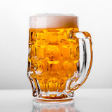 Glass of fresh beer on white background.  Royalty Free Stock Photography