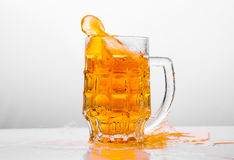 Glass of fresh beer on white background Royalty Free Stock Photography