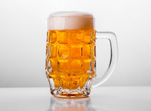 Glass of fresh beer on white background Stock Image