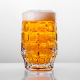 Glass of fresh beer on white background Stock Photos
