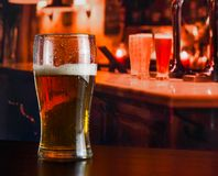 Glass of fresh beer on wood table Stock Images