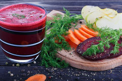 Glass of fresh beetroot, apple and carrot juice Royalty Free Stock Images