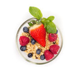 Glass of fresh berries with muesli isolated on white background top view. Flat lay. Ripe Sweet Strawberry, Raspberry, Blueberry, Mint Stock Photography